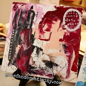 Abstract art using family of pinks and reds, black, white